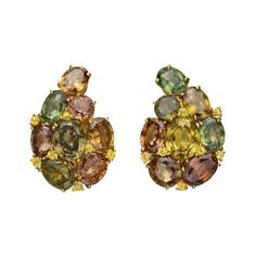 """""""Paisley"""" earclips, designed as a foliate pattern of oval-shaped and circular-cut green and brown tourmalines, accented by fourteen round-cut yellow diamonds, mounted in 18k yellow gold, with omega-style clip backs (posts may be added upon customer request), numbered VEC4053, signed Verdura. 1.25″ length and 0.9 width at widest point."""