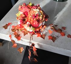 www.bouquetchicunique.co.uk Falls/autumnal themed wedding. Keepsake, alternative, bridal bouquets, oranges, reds, berries, leaves.