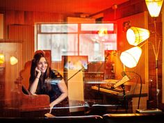 I really like this picture of Marion Ravn, Norwegian singer/songwriter:)  And OH MY GOD, THOSE LAMPS!!  WANT them!  I've always wanted those kind of lamps.  (Photo by Jørgen Braastad)