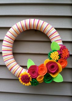 love the colors for spring! Pink, Orange, Yellow, and Green Yarn Wreath with Felt Flowers - great for Summer. $40.00, via Etsy.