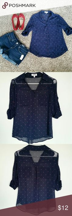 Navy Heart Blouse NWOT never worn, no flaws. Navy Blouse with little pink hearts (shown close up in last photo). Sleeves can either be worn buttoned up or long. Drapy sheer fabric is see-through. Fits xs or fitted small. Express Tops Blouses