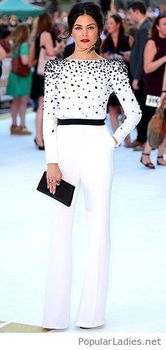A white jumpsuit with a black bag