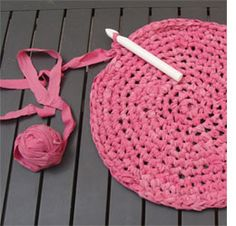 Crochet rug out of old sheets, comforter covers and pillow cases....I like!
