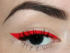 Defined red eyeliner. Either no eyeshadow or heavy, smokey black eyeshadow (if it still allows the eyeliner to pop).