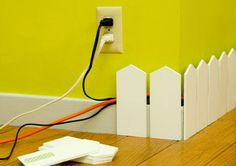 cut idea to hide wires.especially in a play room, rec room or kids room.However, if I was using in a play room or kids room I wouldnt use a picket fence but a rounded top - Diy for Home Decor Hide Cables, Hide Wires, Hiding Cords, Hide Electrical Cords, Electrical Outlets, Diy Home Decor, Room Decor, Church Nursery Decor, Kid Decor
