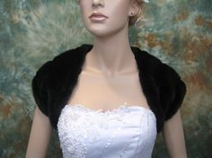 This is a beautiful black faux fur bridal shrug which is fully lined. Its perfect for your wedding or other special occasions. We have small, medium, large and x-large sizes available.    Small size normally fits US size 0-4;  Medium size normally fits US size 6-8;  Large size normally fits US size 10-12;  X-large size normally fits US size 14-16.