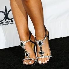 37d5f1a5358 Closeup of the Dsquared2  Queen Mary  jeweled t-strap sandals on Ariana  Grande