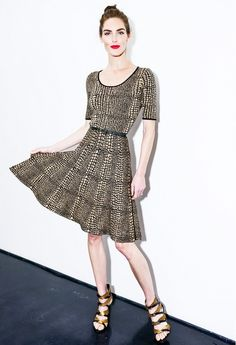 Hilary Rhoda wears a leopard-print fit and flare dress with strappy heels