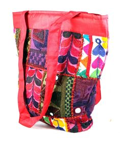 Silk patch work handicraft bag has a classic saddle bag shape, in patch worked diagonal swatches of corduroy, with long strap, media pocket, organizer pocket inside and concealed pocket. #Buyhandbagsonline #HandmadeHandbags #Authenticdesignerhandbags #Womenswallets #Pursesonline #Handmadeitems #Styleincraft