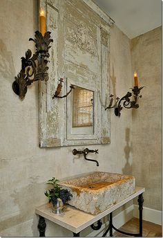 Chippy, rustic and weathered ~ Looks like an old door with a mirror and some trim added..dramatic bath room mirror...