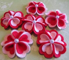 "These Heart blooms would be LOVE-ly as a hair accessory in a little girls hair or as an ornament to decorate with. Each petal in the blooms are shaped just like little hearts.    Size: 2 1/4""    Color: Pink on Red, Red on Pink with pearl center."