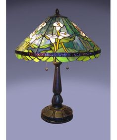 @Overstock - Calla lily table lamp handcrafted using methods developed by Louis Comfort TiffanyIntricate stained glass design and elegant bronze-tone hardwareHome decor in true American style is durable enough to last for generationshttp://www.overstock.com/Home-Garden/Tiffany-style-Calla-Lilly-Table-Lamp/2909134/product.html?CID=214117 $118.99