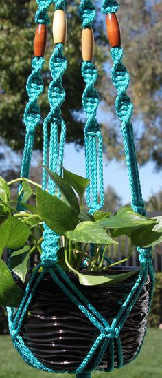 CROWNE ROYALE in TURQUOISE macrame plant hanger by ChironCreation