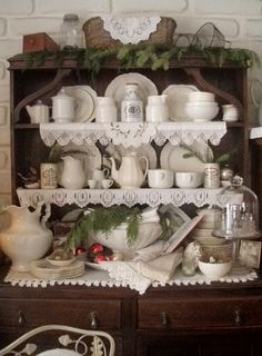 Hutch with white dishes and doilies! Two of my very favorite things:)