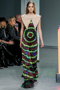 this dress shows rhythm through the repeating pattern of colours but also the radiation from the stomach.