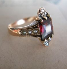 Garnet, Seed Pearl, and Rose-Cut by looks antique - My Mom has a very similar ring and it's her Birthstone! Old Jewelry, Art Deco Jewelry, Antique Jewelry, Jewelry Box, Jewelry Rings, Vintage Jewelry, Jewelry Accessories, Jewelry Design, Jewlery