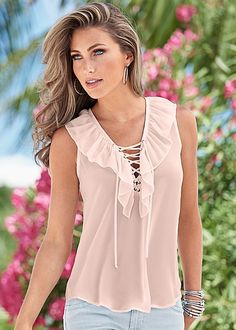 The lace ruffle combo you didn't' know you needed! Venus lace up ruffle top.