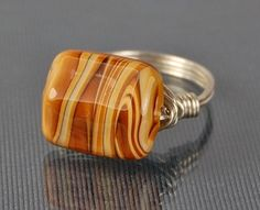 Butterscotch Swirl Lamp work Glass Bead- Silver Wire Wrap Ring  Love the colors