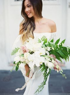 Bride with Large Tropical Bouquet | Tracy Enoch Photography on @bajanwed via @aislesociety