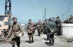 German forces move into Dunkirk. Disarmed French soldiers file pass German officers on the outskirts of Dunkirk. The evacuation of the British Expeditionary Force had been completed a few hours earlier