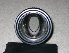 The aperture of the lens (the entrance pupil), as seen from the front, appears as an oval.