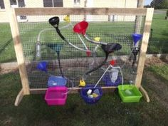 water wall with funnels, pipes, containers on mesh fence. I know 2 little boys that love to play in water.  They would love this!