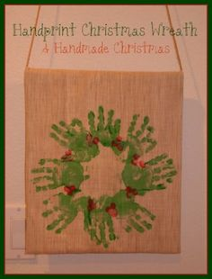 Hand print Christmas wreath.