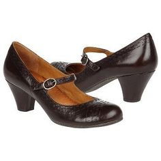 Wide brown shoes with low heel.