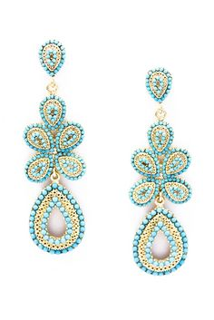 """Indian Turquoise Dangle Earrings  Imported  The Daya earrings feature turquoise beading set with Swarovski crystals and silver. These oversized statement earrings are a nod to both the scale of royal Indian jewelry as well as the glamour of modern Bollywood. We can see Indian actress and former Miss World, Ashwarya Rai wearing Daya with a simple LBD as part of her signature style to give her that instant pop of color.    Material Metal, Swarovski Crystals, & Acrylic  Size 3"""" drop"""