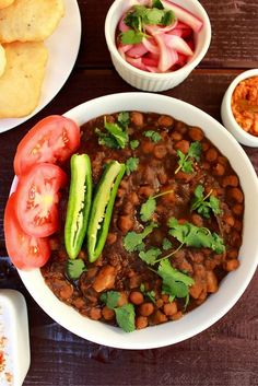 Instant Pot Chickpea Potato Curry is a delicious, satisfying vegetarian dish. This is an easy to make Indian curry. Chickpeas and potatoes are pressure cooked and simmered in tomato puree and are served with hot India bread Bhatura or poori.