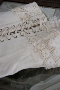 vintage corset- cofuld buy a new one and sew on lace