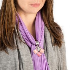 "This Triple Stone Scarf Jewelry with pink and stones will definitely add a splash of color to any outfit. This scarf jewelry features two light pink stones & one fuchsia stone with two floral accents and a striped silver ring. It measures approx. 2"" with a 3/4"" ring. Scarf not included."