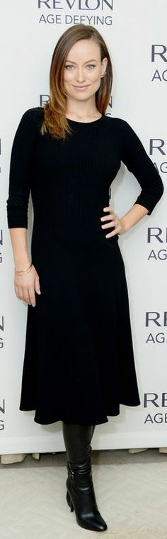Who made Olivia Wilde's leather boots, jewelry, and black long sleeve flare dress that she wore in New York on December 11, 2013?
