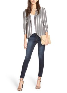 Crushing on this bold blazer with stripes paired with dark denim and heels for a chic business casual look.