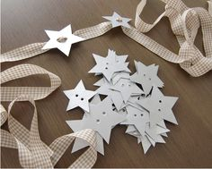making napkin rings with cardboard stars and ribbons