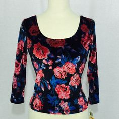 Material Girl Crop Top floral print This Material Girl Crop Top floral print is an eye catcher. It hugs the figure and shows off the waist. Soft to the touch - great for every day wear.   New with Tag  Retail: $59.50  Size Small 28-in Bust 26-in Waist 30-in Sweep 12-in Shoulder 17-in Sleeve 20-in Length (*Measured from neck line to waist hem)  Machine Wash / Tumble Dry Imported Polyester / Spandex Material Girl Tops Crop Tops