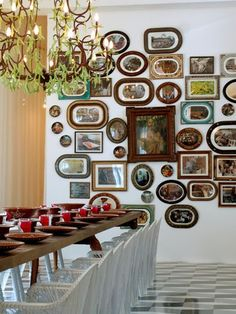 "Gallery wall with a mix of oval and square frames. Subtle design detail: the square frames are in an ""X"" with the ovals filling in the gaps."