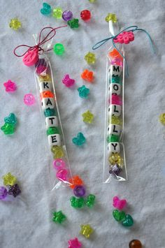 Kids Party Craft, Handmade unique birthday party favor, do it yourself craft bracelet favor  This is a set of beads personalized with each childs name in a clear cellophane sleeve tied up with cord that can be used to make a bracelet. Each is tied up with beading cord long enough to make a bracelet or necklace (depending on the length of the name) with the beads provided. Cord provided is long enough to make a necklace or can be trimmed down for a bracelet. The cord is tied in a bow with a…