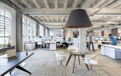 Best offices have a lot of natural light, knock out some brick and don't obstruct the light ways - don't put a wall or office where a window is.