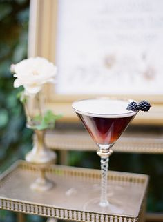 A blackberry thyme champagne cocktail | Brides.com