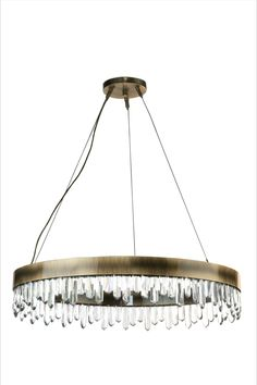 The allure of Mexico's Giant Crystal Cave was the inspiration for NAICCA Suspension Light, a round chandelier that represents the legend of crystal origins. The aged brushed brass structure and the Quartz crystal diffuser merge together to brighten any home decor, filling the room with a strong yet peaceful atmosphere.