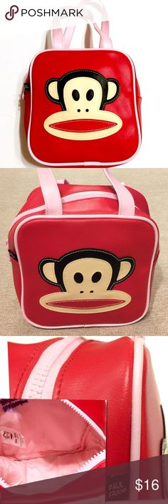 """PAUL FRANK Small Red & Pink Purse Bag Brilliant red color, with pink piping & straps. Authentic Paul Frank mini square purse. Julius the monkey on front. Material: Vinyl Measurements: height-7"""" width-7"""" Depth-3"""" Strap Drop-5.5"""" Excellent condition *minus the name written on the interior corner. Only used 2 or 3 times. Smoke and pet free. Paul Frank Bags"""