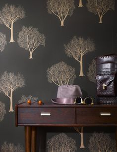 love the idea of a stencil painting like this on the walls-doesn't have to be trees