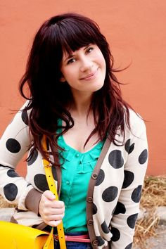 I can totally see myself wearing this whole look! Love the polka dot sweater and the bright yellow purse! :)
