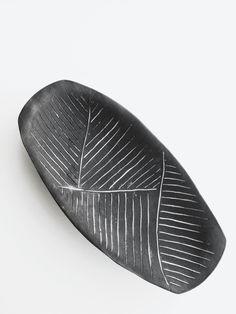 Ceramic Handmade carved platter tray Home Decor Cassius black clay white glaze. $38.00, via Etsy.