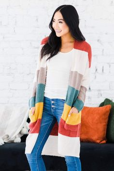 "We are so obsessed with our Berkley Color Block Duster Cardigan, and you will be too! It features a trendy striped color block design, ribbed cuffs and hem, a gorgeous longer length, and pockets of course! Our cardigan is so comfortable and easy to style, trust us when we say it goes with everything! Model Info: Models are 5'7"", Size 2, wearing smalls Body Length Measures 39"" on size medium Sleeve Length Measures 30"" on size medium Fabric: 66% Acrylic, 31% Nylon, 3% Spandex Block Design, Kimono Top, How To Wear, Color, Colour, Paint, Colors"