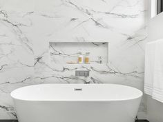 Marble bathroom feature wall Bathroom Feature Wall, Clawfoot Bathtub, Bathroom Ideas, Marble, Projects, Log Projects, Blue Prints, Granite, Marbles