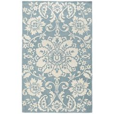 Give any room an inviting foundation via this hand-tufted rug. Displaying a nature-inspired damask pattern in cool white-on-blue, it's traditional while resisting over-complication. And its 100% wool construction? Well, that just makes it irresistible.