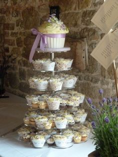 Lilac and lavendar wedding giant cupcake...I kind of like the whole giant-cupcake-on-top thing.