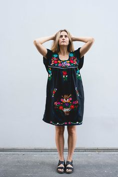This dress was hand embroidered in Oaxaca. It is an authentic Mexican dress or tunic in black. The medium can fit a size small or medium woman comfortably.